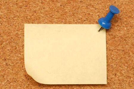 macro of blank note thumbed tacked on corkboard photo