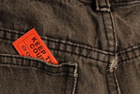 ticket in back pocket of pair of pants or jeans Stock Photo - 4149709