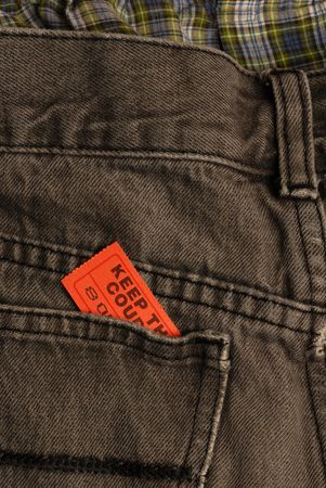 ticket in back pocket of pair of pants or jeans Stock Photo - 4149710