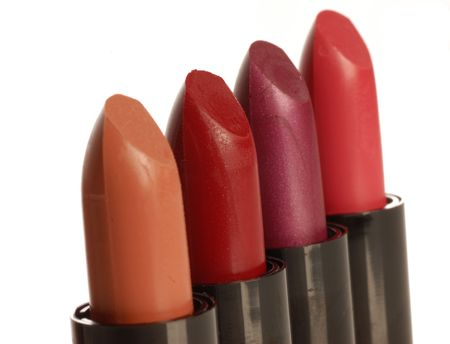 close up of different color lipsticks against a white background photo