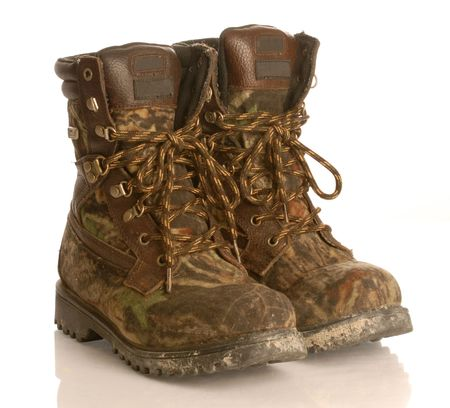 combat boots: camouflage hunting boots isolated on white background Stock Photo