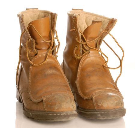 worn work boots or safety boots isolated on white background photo