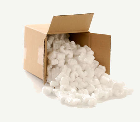 fragile: Cardboard carton filled with polystyrene foam chips  Stock Photo