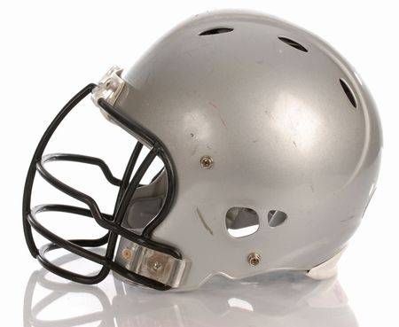 scratched football helmet with reflection on white background photo