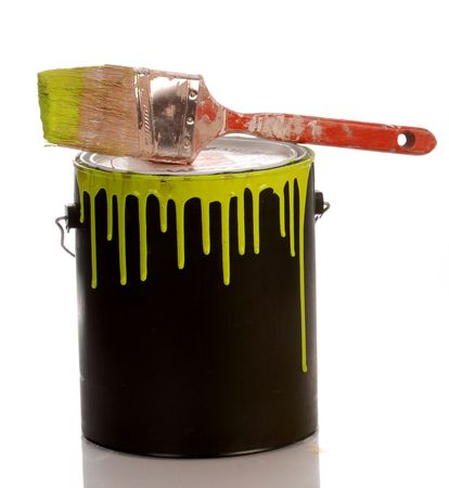 paints: messy yellow paint can with paint on white background