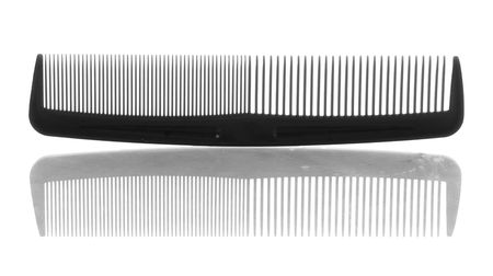black plastic hair comb with reflection on white background Stock Photo