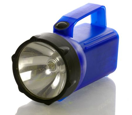 torchlight: large blue flashlight with reflection on white background    Stock Photo