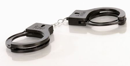 cuffs: toy hand cuffs with reflection on white background
