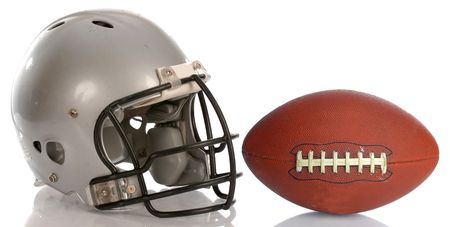 protective football helmet and leather football with reflection photo