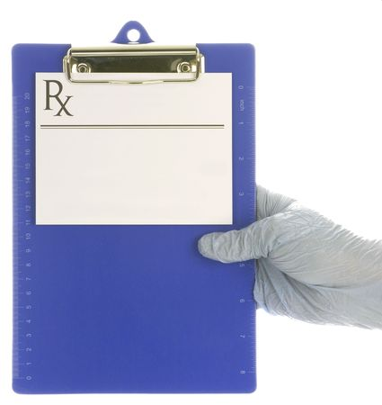 gloved hand holding medical clipboard with prescription pad  photo