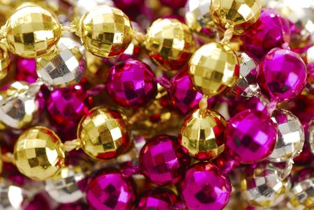 background of colorful mardi gras beads including gold, silver and pink photo