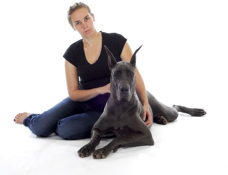 great dane dog laying beside young woman with reflection on white background Stock Photo - 8164420