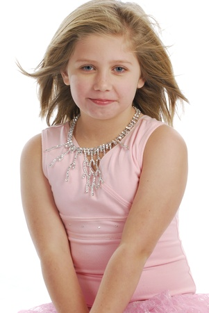 adorable young girl wearing pink tutu on white background photo