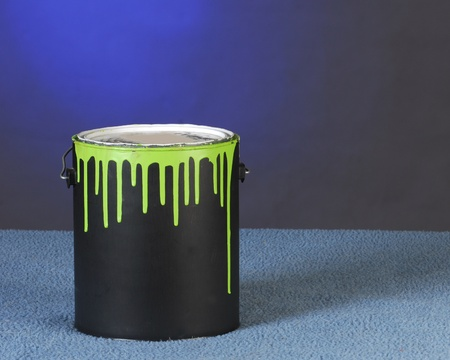 paintbucket: can of paint with drips on can on blue background