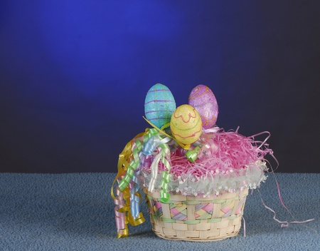 easter basket with colorful eggs on blue background Stock Photo - 9378023