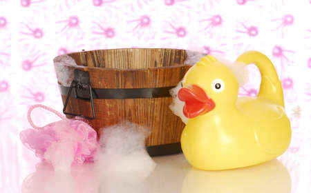 wash tub: wooden wash tub and rubber duck with soap suds