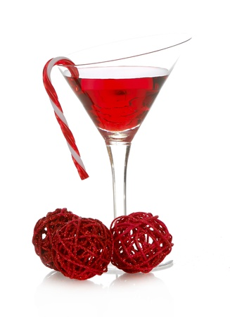 christmas cheer - colorful cocktail with candy cane on the side isolated on white background photo