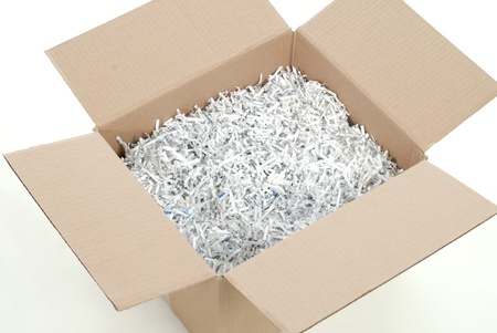 cardboard box full of shredded paper - packing box on white background photo