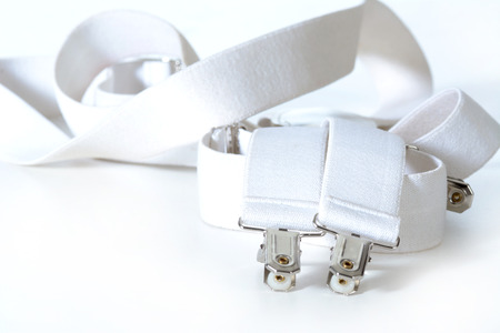 leatherette: white suspenders isolated on white  Stock Photo