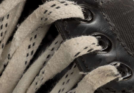 rink: laces details on pair of worn hockey skate