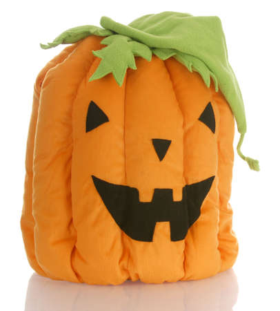 reflection: stuffed pumpkin or jack-o-lantern with reflection on white background Stock Photo