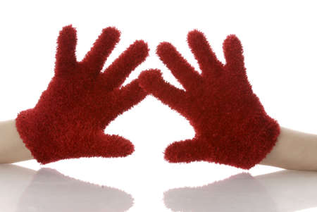 alarming: persons hands wearing red mittens with reflection on white background Stock Photo