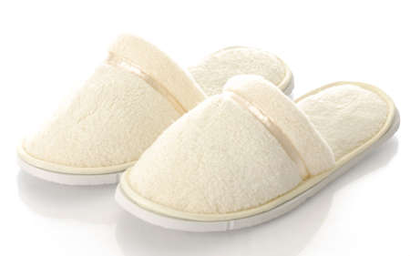 fuzzy: pair of womens fuzzy slippers with reflection on white background
