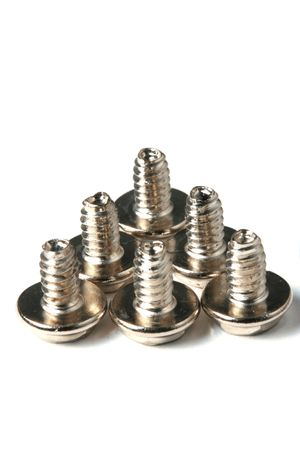 The chromeplated fixing screws for a computer Stock Photo
