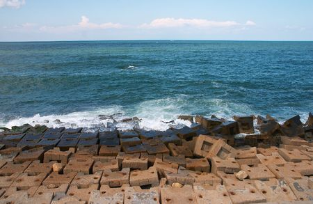 Artificial coast from concrete of Protected stone blocks Stock Photo