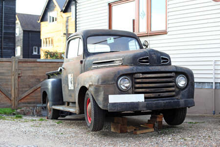 rusty car: Old rusty and damaged black pickup truck