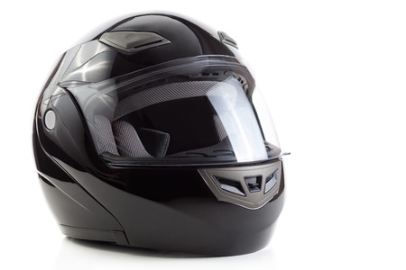 Black flip up helmet for racing motorbike sports photo