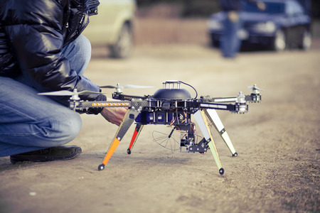 taking video: Preparing to filming video using quadrocopter flying drone