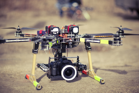 Preparing to take aero photo using octocopter flying drone Stock Photo