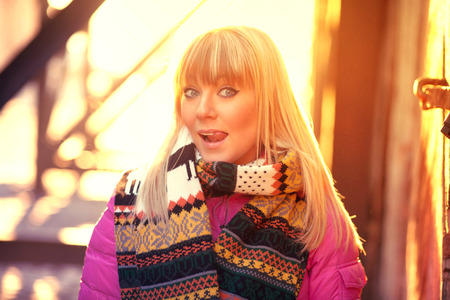 exhalation: Funny blonde playing and fooling around in the winter city Stock Photo
