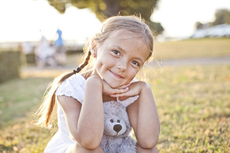 latvia girls: Happy child in a park Stock Photo