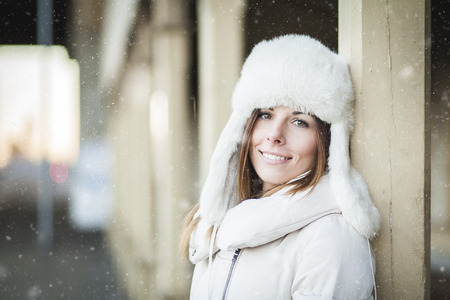 a blizzard: Smiling young woman in blizzard