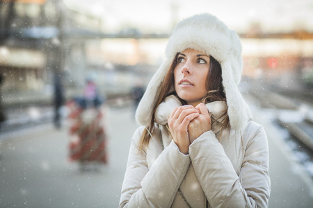Young woman feeling cold in winter day photo