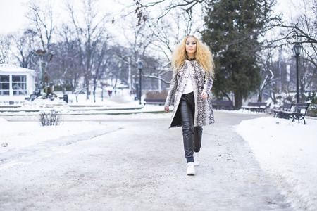 latvia girls: Blonde girl in the park on a winter day Stock Photo
