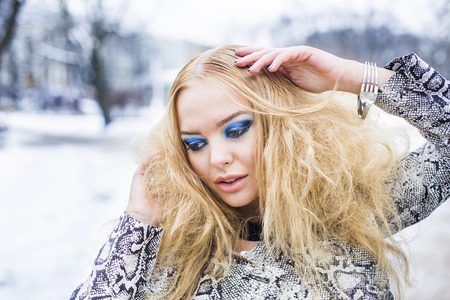 latvia girls: Blonde lady is posing in the winter