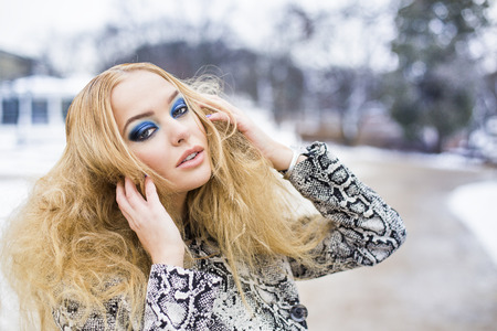 latvia girls: Golden haired woman posing outside