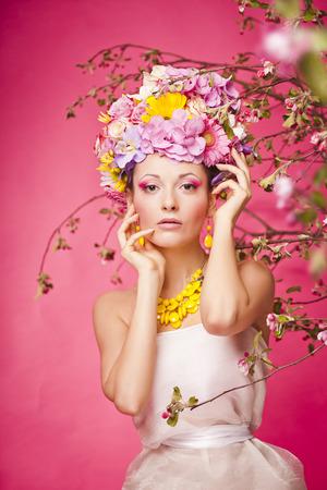 make up model: Fresh skin Girl with Spring Flowers on her head