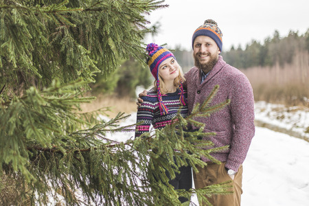 scandinavian people: Young couple hugging in winter forest