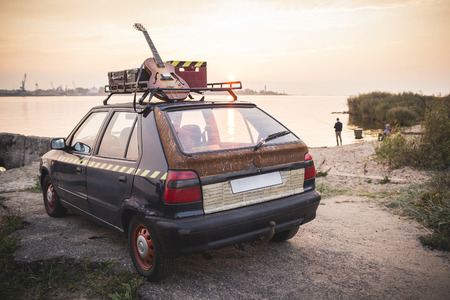Old rusted hippie car freedom concept on coast Stock Photo