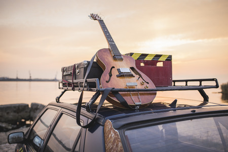 guitars: Music instrumental guitar car outdoor background Stock Photo