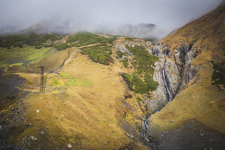 crack climb: Georgian nature tourism waterfall in mountains
