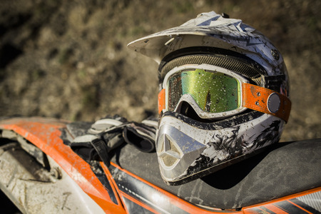 bicycle helmet: Dirty motorcycle motocross helmet with goggles