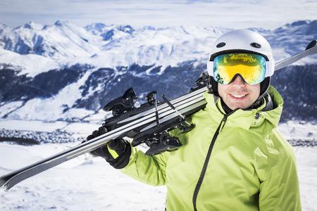 ski goggles: Young successful men ski mountain winter resort