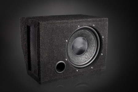 dolby: Black subwoofer speaker car audio music system Stock Photo