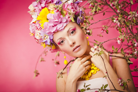 latvia girls: Beautiful healthy girl with spring flowers crown Stock Photo