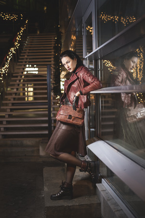 dangerouse: Beautifull lady in leather clothes near city club